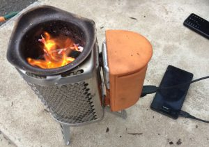 Portable biochar cooker will also recharge a mobile phone