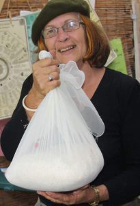 Robyn Francis ready to hang the grated cassava overnight