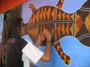 Gilbert Laurie painting mural