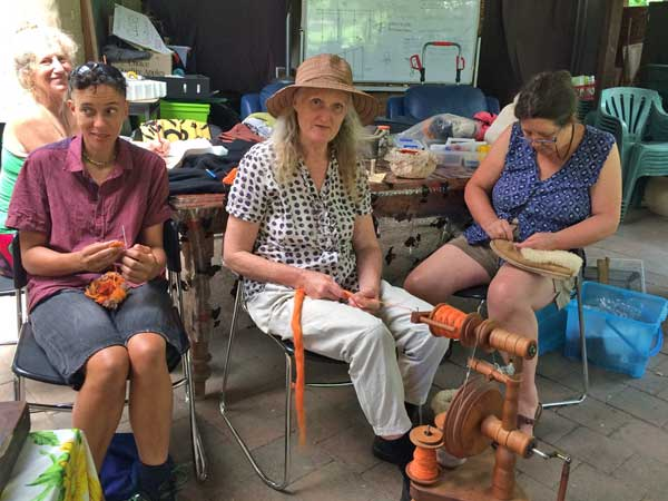 Mending clothes, boots, and spinning st Nimbin Repair Cafe