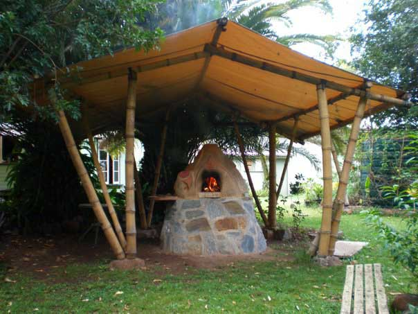 Bamboo shelter over cob oven in Ravenshoe