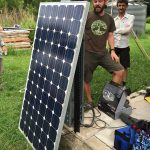 Guy Stewart with the salvaged solar panel