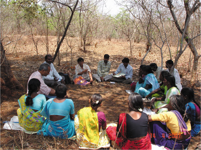 Narsanna working with village farmers in the Deccan, India